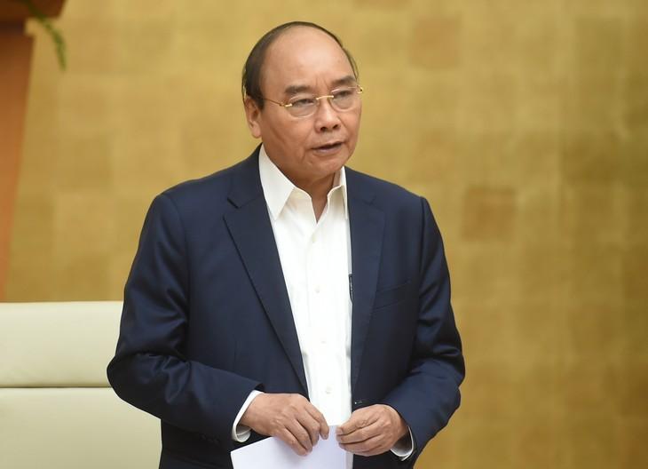 El control de la pandemia se atribuye a la fuerza de la unidad nacional, afirma el primer ministro de Vietnam - ảnh 1