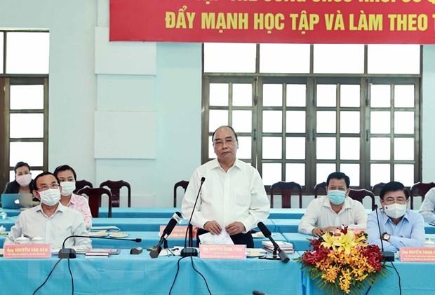 Presidente de Vietnam se reúne con las autoridades de distritos de Ciudad Ho Chi Minh - ảnh 1
