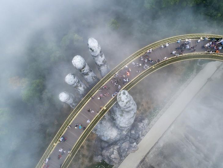 Cau Vang หรือสะพานทองที่ Ba Na Hills นครดานัง ติดรายชื่อสะพานที่สวยที่สุดในโลก - ảnh 9