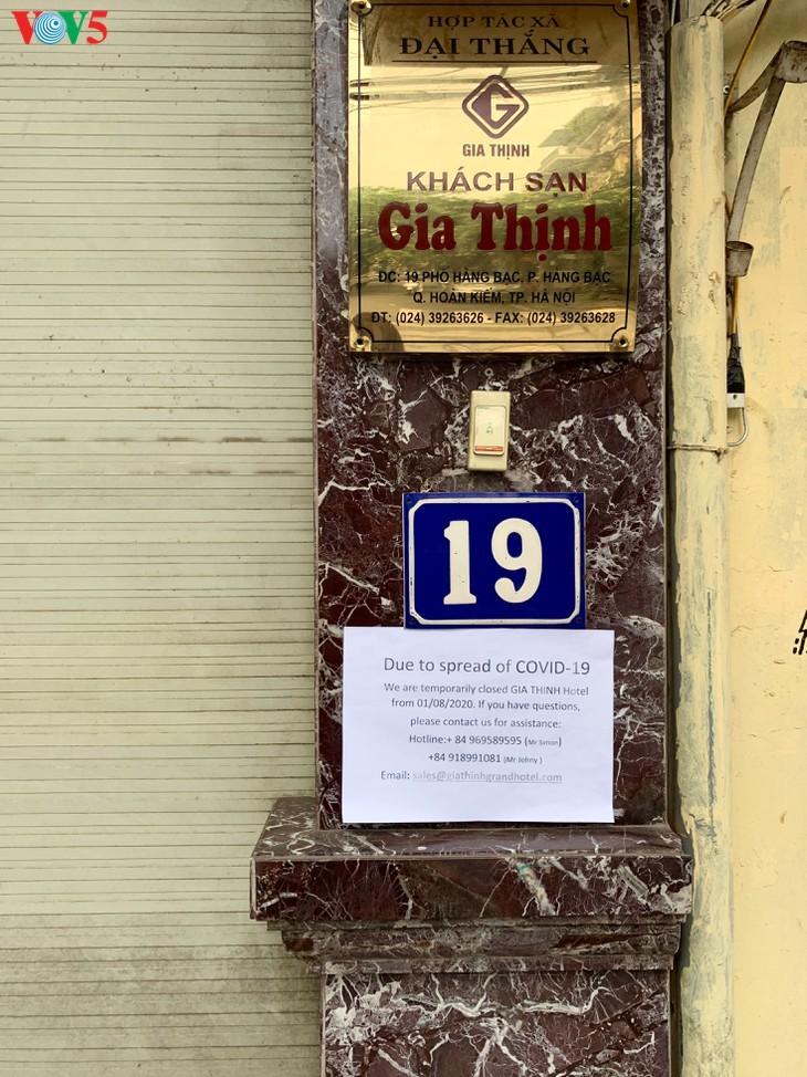 บรรยากาศย่านโบราณ 36 สายในกรุงฮานอยที่ได้รับผลกระทบจากโรคโควิด-19 - ảnh 12