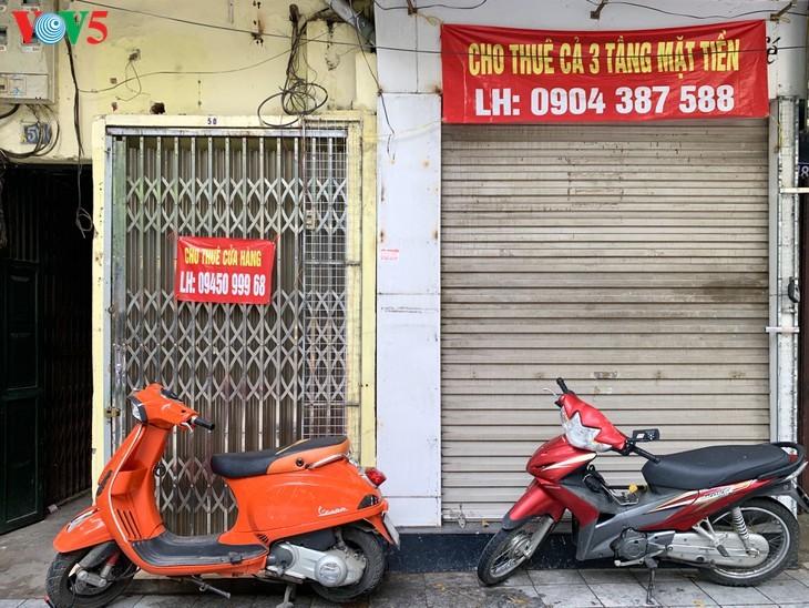 บรรยากาศย่านโบราณ 36 สายในกรุงฮานอยที่ได้รับผลกระทบจากโรคโควิด-19 - ảnh 18