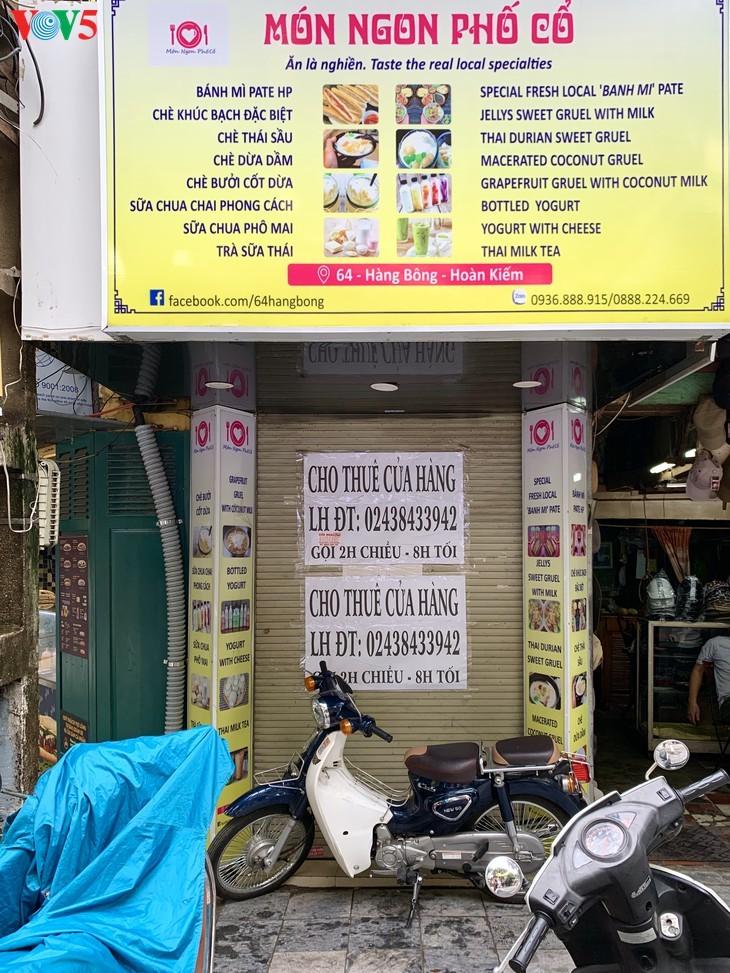 บรรยากาศย่านโบราณ 36 สายในกรุงฮานอยที่ได้รับผลกระทบจากโรคโควิด-19 - ảnh 19