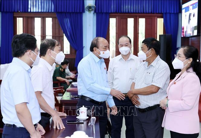 ประธานประเทศ เหงียนซวนฟุก พบปะกับผู้มีสิทธิ์เลือกตั้งนครโฮจิมินห์ - ảnh 1