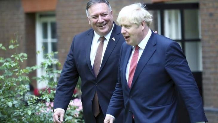US, UK tighten cooperation against external threats  - ảnh 1