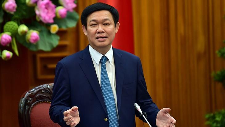 Vizepremierminister Vuong Dinh Hue nimmt an Bilanzkonferenz zur Wirtschaftsentwicklung teil - ảnh 1