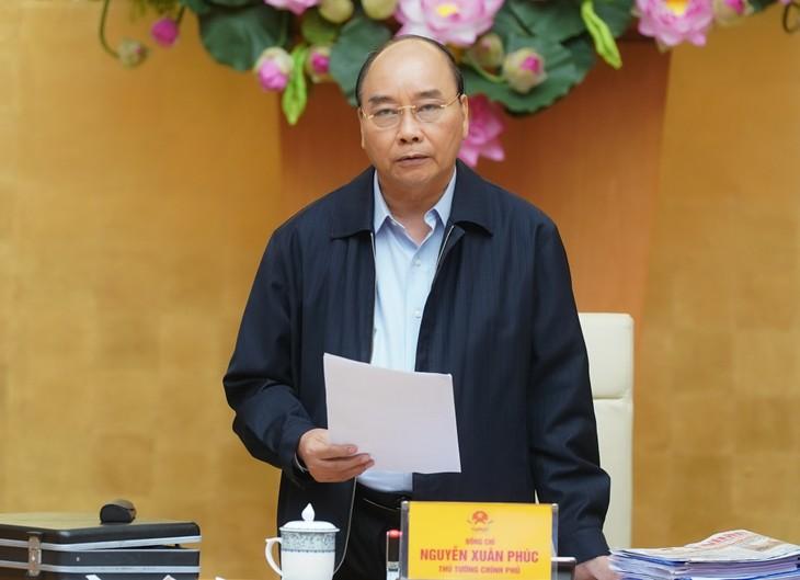 Premierminister Nguyen Xuan Phuc stimmt der Ankündigung der landesweiten Covid-19-Epidemie zu - ảnh 1