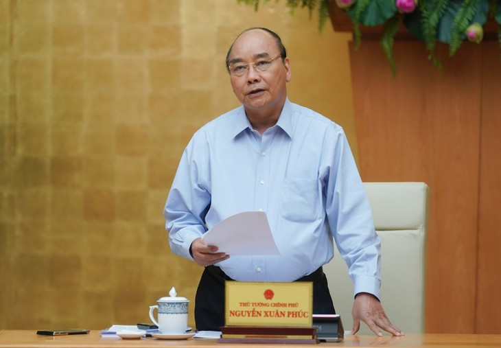 Premierminister Nguyen Xuan Phuc: Vietnam hat die Covid-19 grundsätzlich beseitigt - ảnh 1