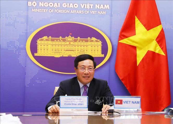 Vizepremierminister Pham Binh Minh nimmt an der Onlinekonferenz der Außenminister der G20 teil - ảnh 1