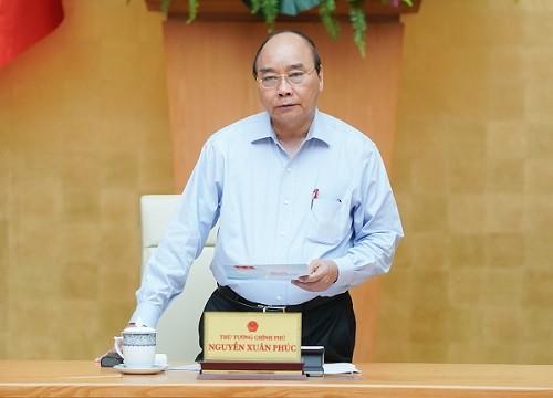 Premierminister Nguyen Xuan Phuc leitet Regierungssitzung über Covid-19-Bekämpfung - ảnh 1