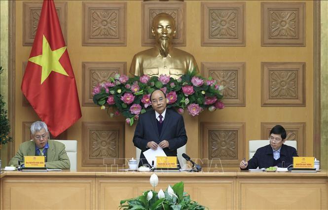 越南政府总理阮春福与经济咨询小组举行工作座谈 - ảnh 1