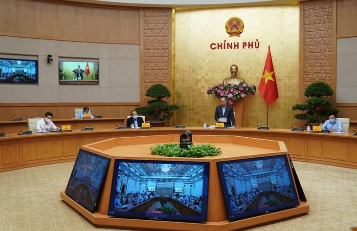 越南政府举行应对新冠肺炎疫情全国视频会议 - ảnh 1
