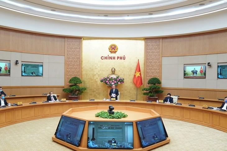 越南政府总理与企业会议 疫情下重启经济 - ảnh 1