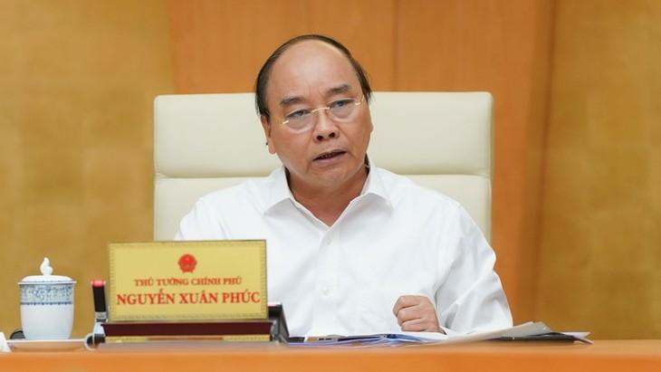 越南政府总理:新冠肺炎大流行病演变复杂但仍处在控制之下 - ảnh 1
