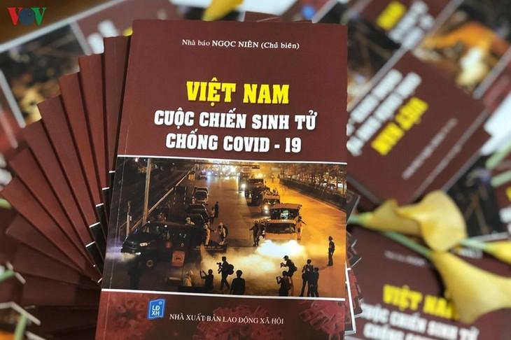 """Buchpremiere """"Vietnam - erbitterter Kampf gegen Covid-19"""" - ảnh 1"""