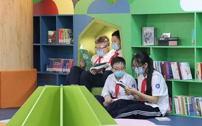 Verbindungen der Kinder mit Büchern - ảnh 1