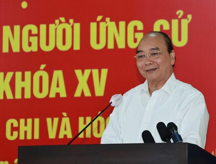 Staatspräsident Nguyen Xuan Phuc trifft Wähler in Ho Chi Minh Stadt  - ảnh 1