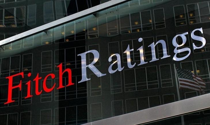 """ອົງການຈັດອັນດັບຄວາມໄວ້ວາງໃຈ Fitch Ratings ຍົກລະດັບແງ່ຫວັງຂອງຫວຽດນາມ ຈາກລະດັບ """"ສະຖຽນລະພາບ"""" ຂຶ້ນເປັນ """"ຕັ້ງໜ້າ"""" - ảnh 1"""