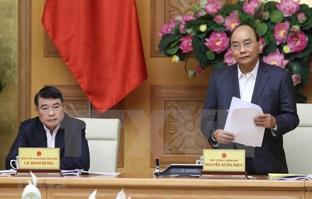 Premier vietnamita ordena fortalecer prevención y lucha contra Covid-19 - ảnh 1