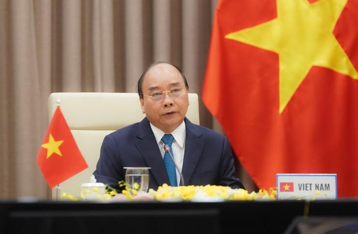 Premier vietnamita asiste a reunión en línea de la OMS - ảnh 1