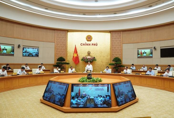 응우옌 쑤언 푹 충리, 공공투자 지출조치에 대한 회의 주재 - ảnh 1