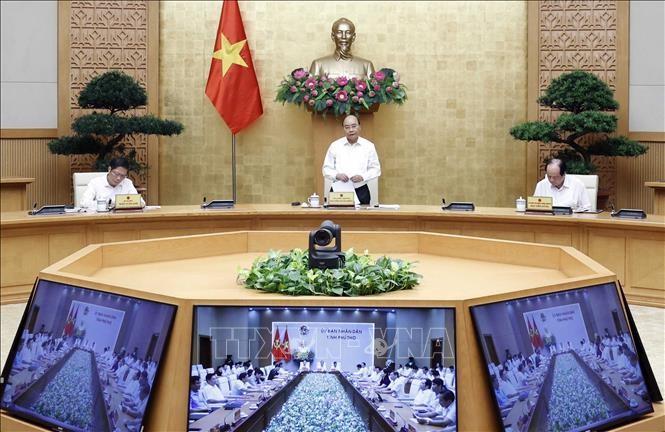 응우옌 쑤언 푹 총리와 푸터성 지도자 간 온라인 회의 - ảnh 1