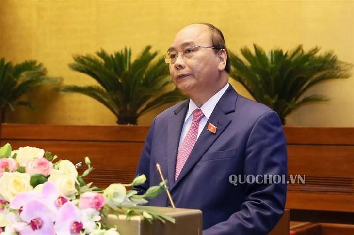 Le Vietnam met tout en œuvre pour éradiquer la Covid-19 et relancer l'économie - ảnh 1