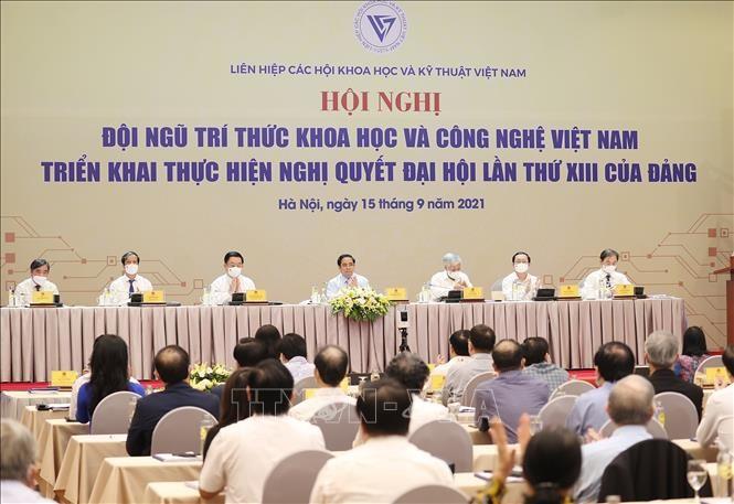 Conférence: Les scientifiques vietnamiens appliquent la Résolution du 13e Congrès national du Parti - ảnh 1