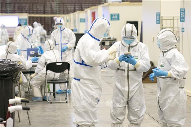 В китайском Хубэе за сутки от коронавируса умерли 242 человека - ảnh 1