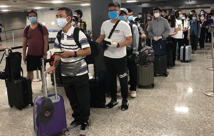 Возвращение вьетнамских граждан из Сингапура и США на Родину - ảnh 1