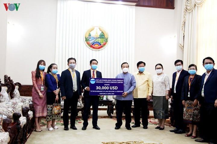 Doanh nghiệp Việt Nam ủng hộ Lào 30.000 USD chống dịch - ảnh 1