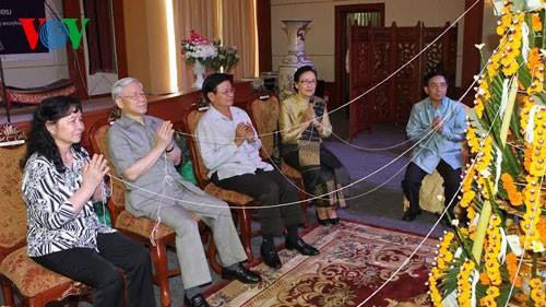 Генсек ЦК КПВ посетил Лаос и поздравил лаосский народ с новогодним праздником - ảnh 2