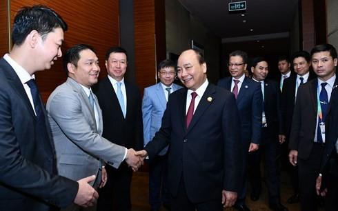 Премьер Вьетнама встретился с представителями деловых кругов Китая - ảnh 1