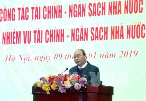 Нгуен Суан Фук принял участие в конференции по подведению итогов работы финансового сектора - ảnh 1