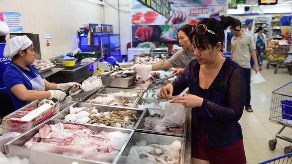 Все районы Вьетнама запасаются товарами на традиционный новогодний праздник - ảnh 1