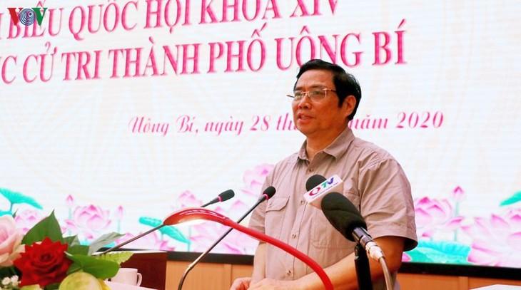 Фам Минь Тинь встретился с избирателями города Уонгби провинции Куангнинь - ảnh 1