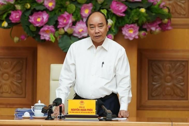 Премьер Нгуен Суан Фук: патриотизм помогает Вьетнаму преодолеть трудности - ảnh 1