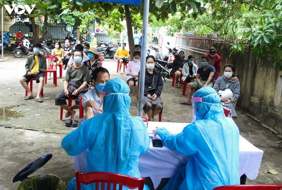 Во Вьетнаме ещё более 16 100 человек проходят карантин из-за COVID-19 - ảnh 1