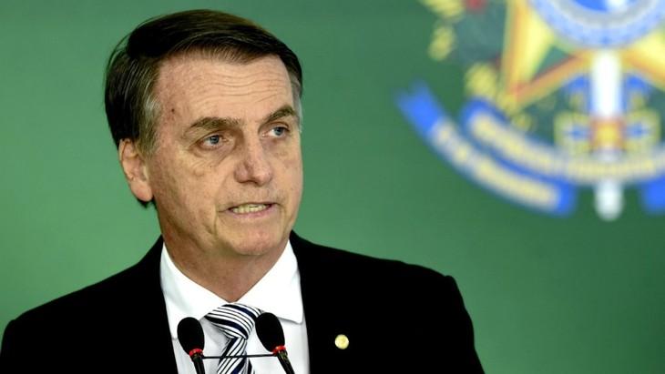 Le Brésil de Bolsonaro va se retirer du Pacte mondial sur les migrations - ảnh 1