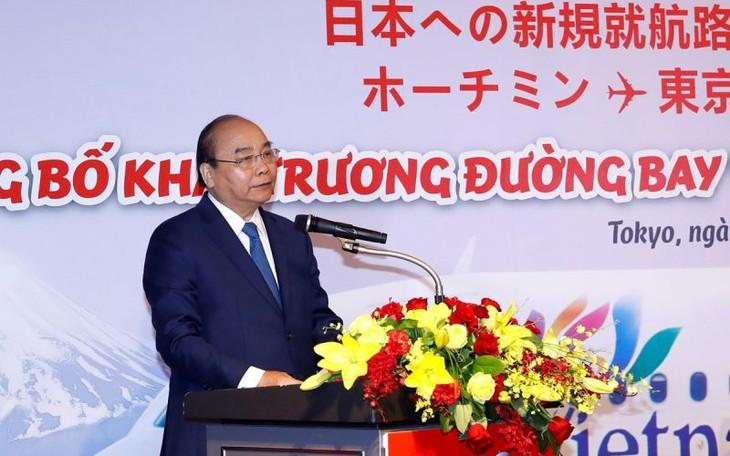 Le PM à la cérémonie de publication de deux nouvelles lignes vers le Japon - ảnh 1