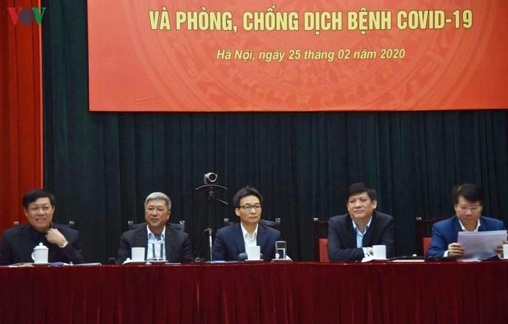 รองนายกรัฐมนตรีหวูดึ๊กดามเข้าร่วมการประชุมป้องกันและรับมือการแพร่ระบาดของโรคโควิด-19 - ảnh 1