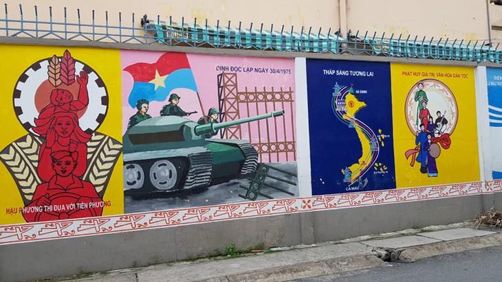 จิตรกรรมฝาผนังในถนนสายต่างๆในนครโฮจิมินห์สื่อถึงคุณค่าที่ดีงาม - ảnh 3