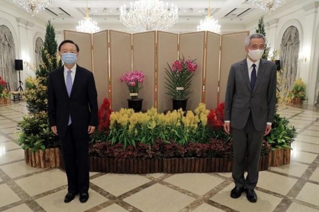จีนพร้อมประสานงานกับอาเซียนเพื่อส่งเสริมสันติภาพในภูมิภาคและโลก - ảnh 1