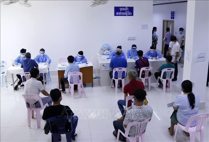 เวียดนามสนับมสนุนเงิน 5 แสนดอลลาร์สหรัฐเพื่อช่วยเหลือพรรค รัฐและประชาชนลาวรับมือการแพร่ระบาดของโรคโควิด-19 - ảnh 1