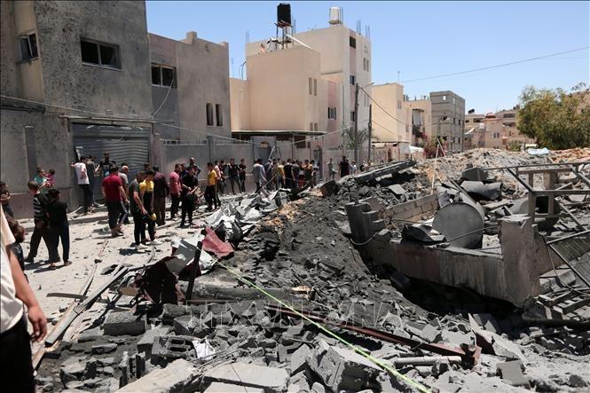 ประชาคมโลกพยายามส่งเสริมให้อิสราเอลและปาเลสไตน์หยุดยิง - ảnh 1