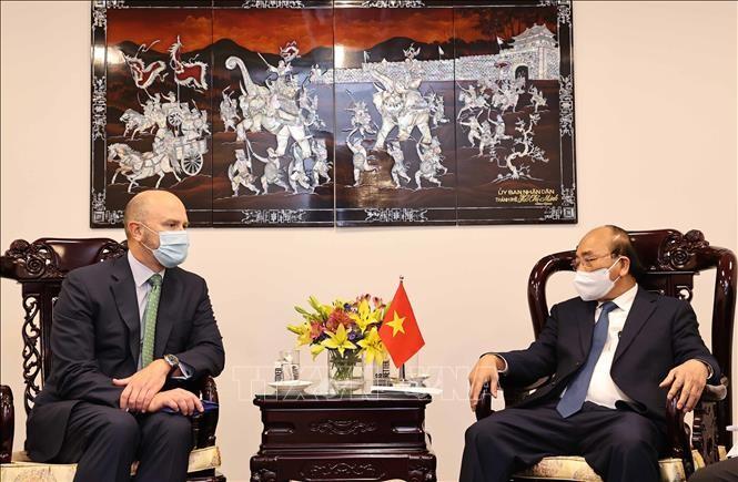 ประธานประเทศเหงวียนซวนฟุกให้การต้อนรับผู้บริหารสถานประกอบการชั้นนำของสหรัฐ - ảnh 1